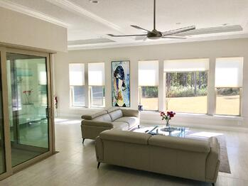 modern living room with shades covering windows
