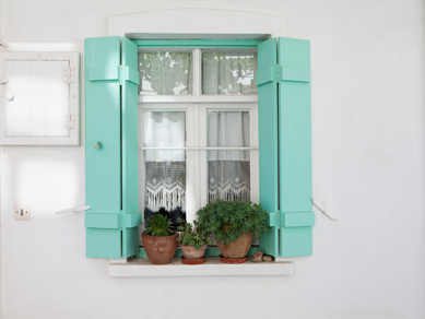Blue exterior shutters with white background