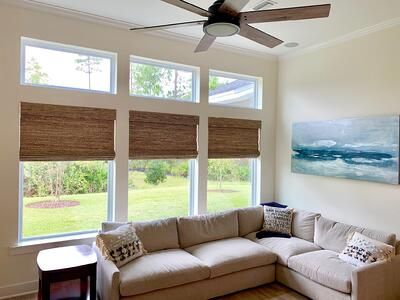 living room with woven wood shades