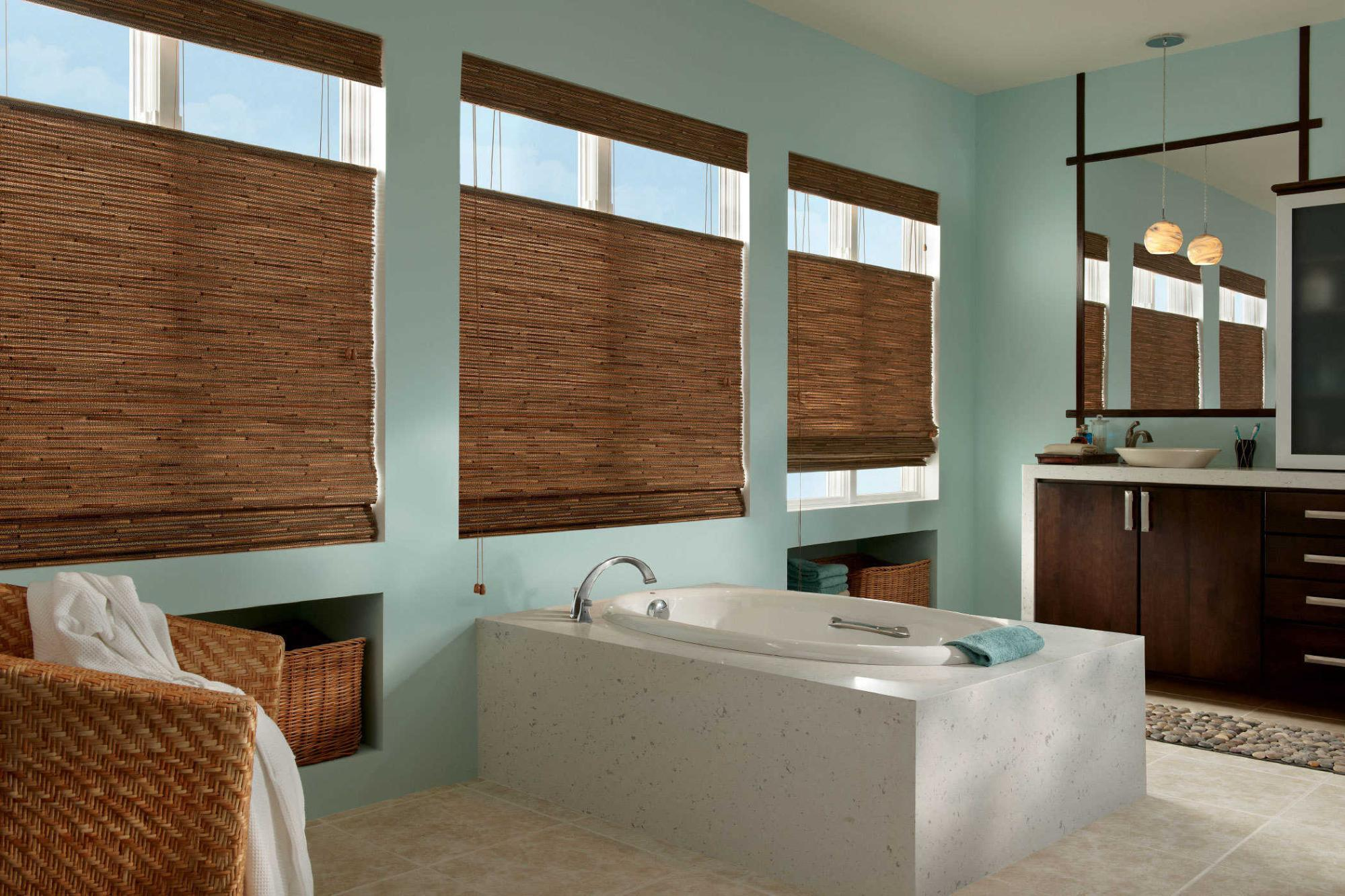 bathroom with woven wood shades